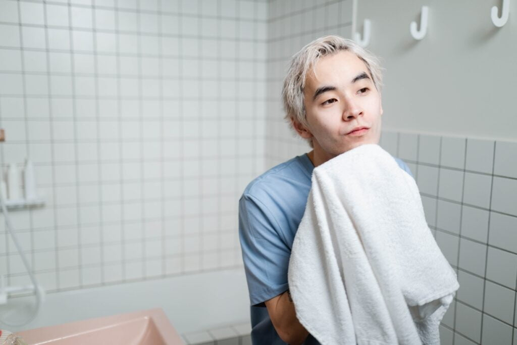 wash your face with a warm towel