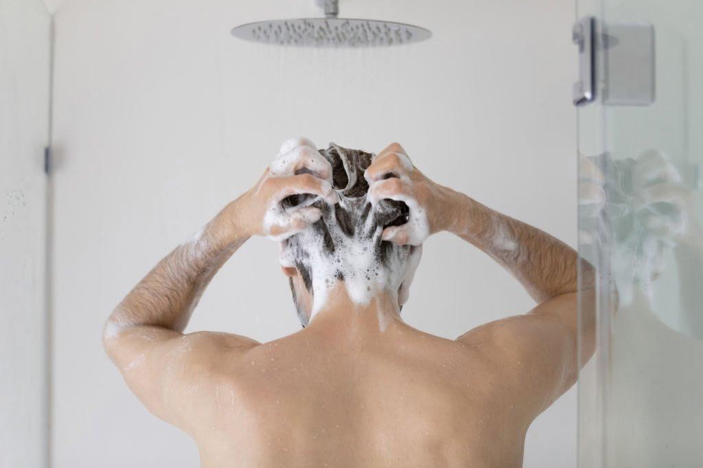 Washing your hair with foamy anti-dandruff shampoo helps
